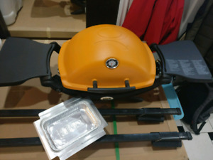 SOLD.  NEW!  Weber portable propane BBQ - orange.  SOLD.