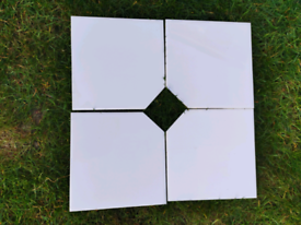 "4 white Ceramic tiles 6"" square. Until 21st April"