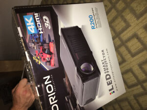 Orion LED smart projector. Brand new in box. Includes screen