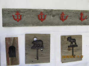 Beautiful cast Iron coat hooks on reclaimed Barnboard