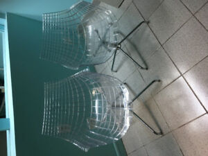 2 clear plastic chairs