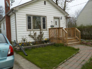 4 Bedroom  Bungalow on Quiet Side Street with Huge Fenced Yard