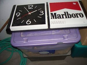 Lighted Marlboro sign with clock