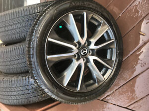 """Used only one season 18"""" rims and tires P215/50R18 92V"""