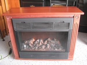 FIREPLACE FREESTANDING  INSIDE  - HEAT SURGE - BLOWS HOT OR COLD