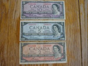 1954 2, 5, and 10 dollar bills.