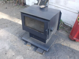 poele combustion lente ideal pour chalet ou garage