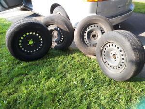 4 Winter Tires on Rims 235 65/R17 Goodrich Slalom+1  Firestone