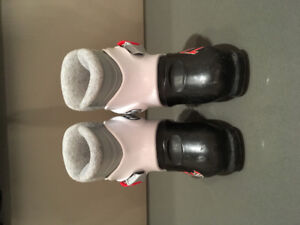 Two pairs of Downhill ski boots.
