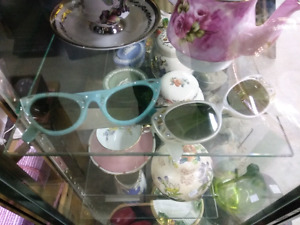 Vintage baby blue cats eye glasses and pearl ones too