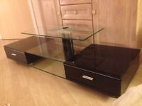 Glass tv unit with storage drawers