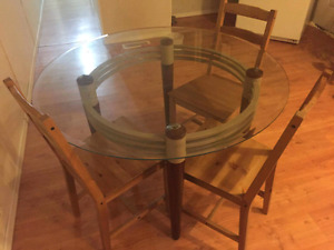 Glass table with 3 wooden chairs