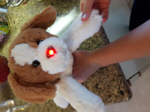 Stuffed dog that barks and lights up