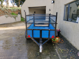 8 x 4 Twin axle caged trailer .