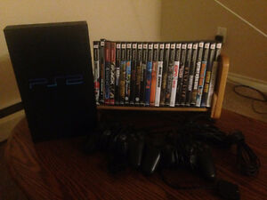 Selling Playstation 2 with 2 controllers and 23 games