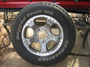 Nissan Xrerra Supercharged Aluminum Rim and tire 265/65/17