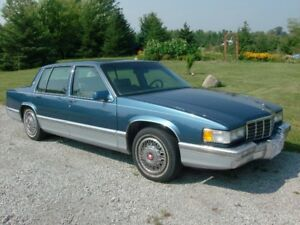 1992 Cadillac, gas and CNG...$890