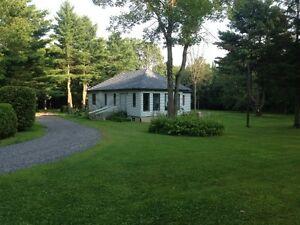 Maison avec 108 913 pi/ca de terrain à vendre à Rigaud