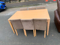 54. Table and 6 chairs
