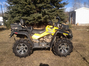 Looking to trade a 2011 Can am 800 XMR for a Side by Side.