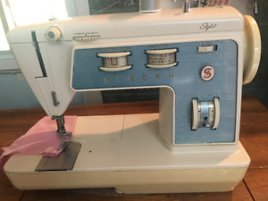 Singer stylist sewing machine and table