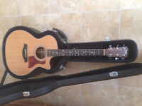 Taylor 314ce with hard shell Taylor case.