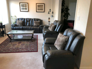 Three piece sofa set with electric recliners