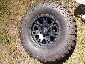 I have one spare Mickey Thompsons tire on Mickey Thompson rim