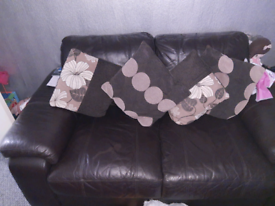 Two two seaters leather sofa