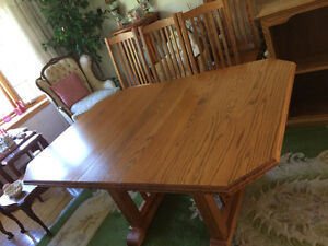 SOLID OAK dining room table and 4 chairs w/ insert..MENNONITES