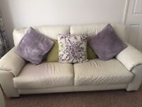 Leather settee, reclining chair and storage foot stool