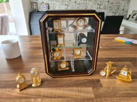 Miniature clocks and display case.