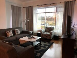 Looking for a Female Professional to Share a 2 BR Condo