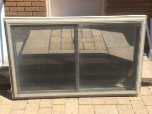 Double slider vinyl window 56 x 34 3/4, (only 2 years old)