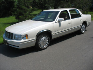 Mint, 1999 Cadillac Driven only 68,000, klms. Pearl White with m