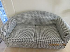 Love seat that converts to bed