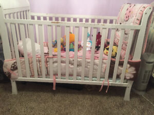 Crib with mattress and bedding