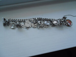 Sterling  Silver Charm Bracelet with 20 +Charms