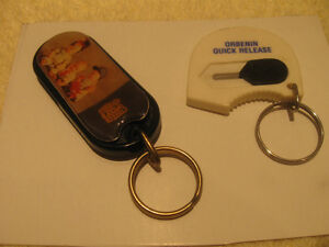 TWO INTERESTING COLLECTIBLE DOUBLE-SIDED KEY RINGS