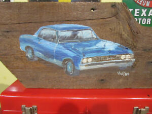 1967 Chevelle tole painted on barnboard.