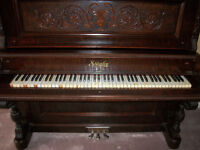 Beautiful Stanley Piano with ivory keys built in 1893.