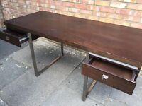 Stylish dark wood desk with aluminium frame