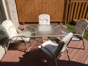 Patio set - dining table and 4 cushioned chairs