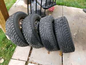 Four hankook winter tires on steel rims