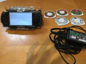 Sony personal portable with 5 game discs
