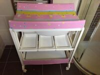 Pink changing stand with bath