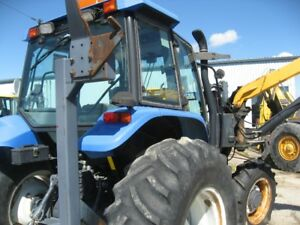 NEW HOLLAND TS110 TRACTOR WITH ALAMO SIDE MOWER