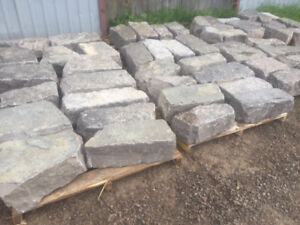 $25 PER LINEAR FOOT OF BOBCAYGEON ARMOUR STONE.