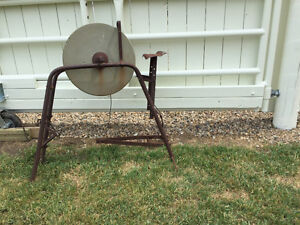 Vintage Grinding Wheel and Wooden Wagon Wheels