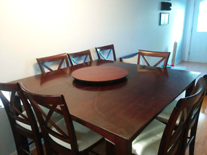 Wood Dinning table with 8 cushioned chairs